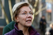 In this Thursday, March 5, 2020, file photo, Sen. Elizabeth Warren, D-Mass., speaks to the media outside her home in Cambridge, Mass. Warren and several U.S. senators are pushing for details from Deutsche Bank AG about contacts with the family business of President Donald Trump, which has asked the German lender for leniency on some of its loans.