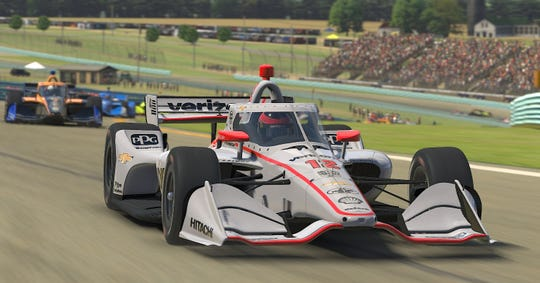 The virtual car of Will Power, driver of the No. 12 Verizon Team Penske Chevrolet,  leads a pack of cars during the IndyCar iRacing Challenge American Red Cross Grand Prix at virtual Watkins Glen International on March 28, 2020.