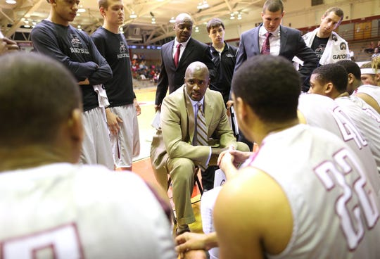 Stan Gouard talks to his UIndy team during a time-out in a 2014 game.
