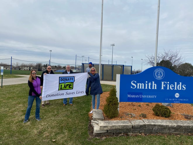 Representatives from Share your Spare, Fond du Lac raised a Donate Life flag Monday on the Marian University Smith Fields Complex flag pole in recognition of National Donate Life Month.