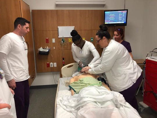 Nursing students at Florida SouthWestern State College work in the simulation lab.