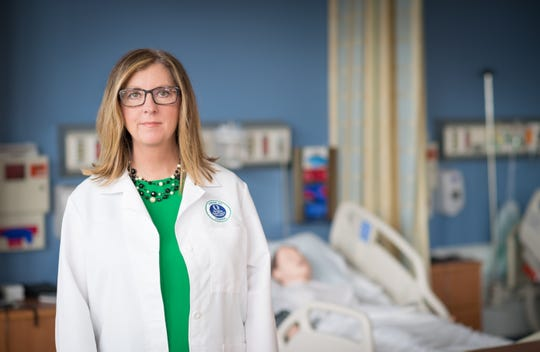 Kelly Goebel is a professor of nursing at Florida Gulf Coast University with a doctorate in the field. She also works for a Collier County hospital.