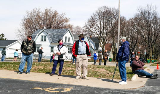 Green Bay residents wait in line to vote on Tuesday at Green Bay West High School. At peak times, some voters had to wait three to four hours.