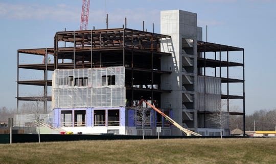 Construction continues on an office building at the Green Bay Packers' Titletown District in Ashwaubenon.
