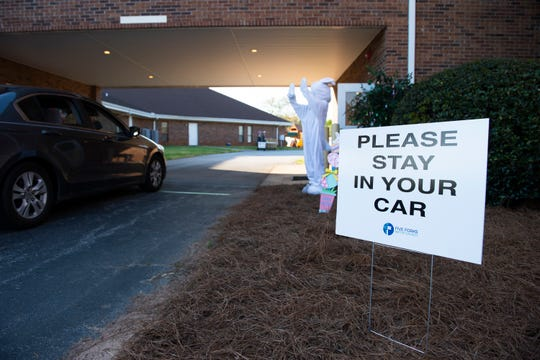 A bunny waves to drivers and passengers at Five Forks Baptist Church during the Drive-Thru Egg Hunt event Sunday, April 5, 2020. Members of the church handed out bags with plastic eggs filled with surprises.