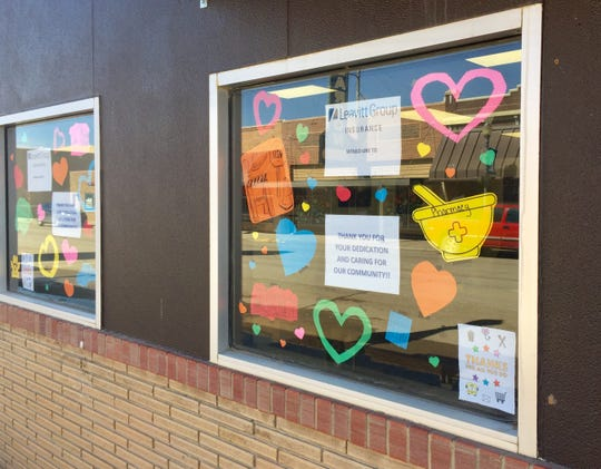 The Leavitt Group on Main Street displays hearts on its front window, in support of those who help during the coronavirus.