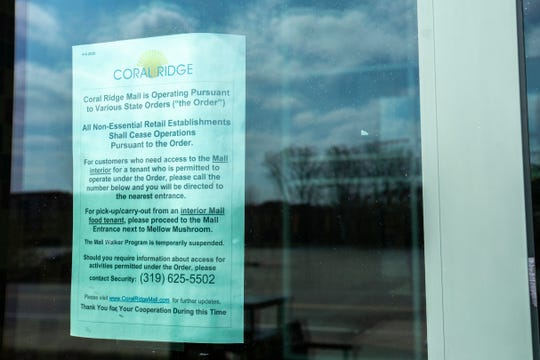 A note hangs on a window near an entrance on the south side of the mall, Tuesday, April 7, 2020, at Coral Ridge Mall in Coralville, Iowa.