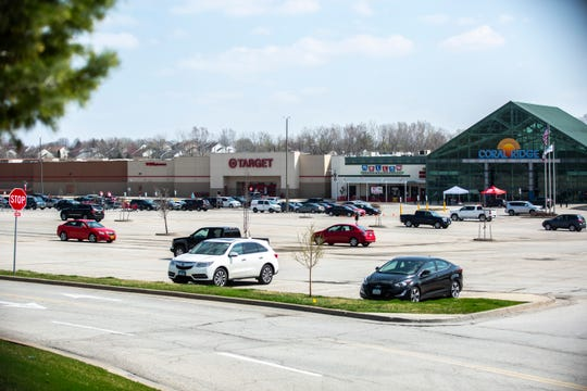 The parking lot is mostly empty on the north side of the Coral Ridge Mall, Tuesday, April 7, 2020, in Coralville, Iowa. Malls across the state were ordered to close by Iowa Gov. Kim Reynolds to combat the spread of COVID-19.