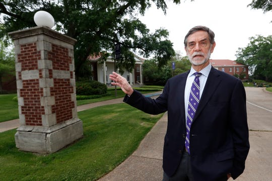 Millsaps College president Robert W. Pearigen speaks about the history of some of the buildings at the small liberal arts college in Jackson, Miss., Friday, April 3, 2020. With students online learning in face of the coronavirus, Pearigen and other small college leaders face an unusual set of financial and enrollment challenges because of the virus.