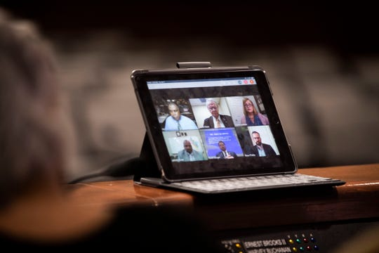Jackson City Council members chat with Mayor Scott Conger via video chat  speaks to discuss their budget at Jackson City Hall in Jackson, Tenn., on Tuesday, April 7, 2020.