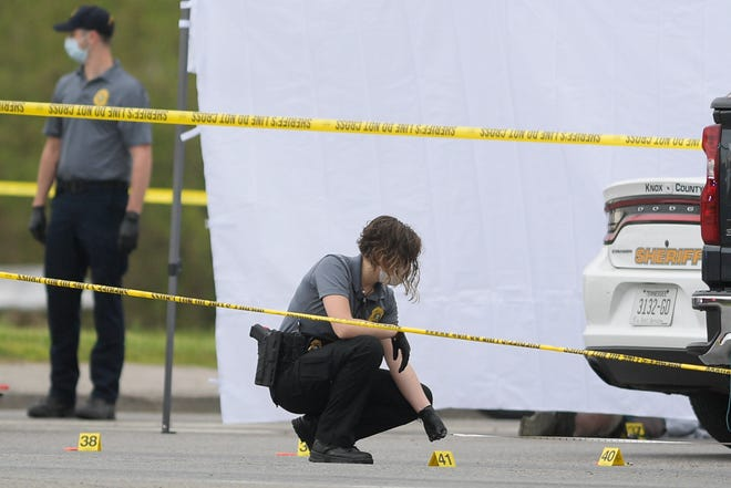 An investigator takes measurements at the scene of a stabbing and shooting at a Pilot truck stop on Strawberry Plains Pike in Knoxville, Tennessee on Tuesday, April 7, 2020. Multiple police agencies including KCSO, KPD, THP and TBI were investigating the scene. Several people were stabbed Tuesday morning at a Pilot Travel Center just off Interstate 40 on Strawberry Plains Pike.