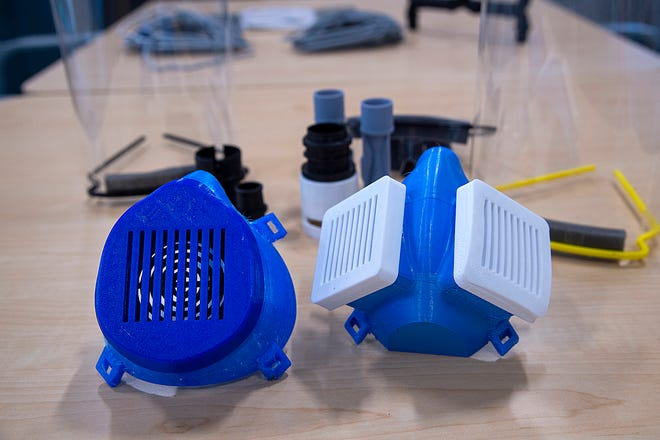 Nate Hartman and his team of Graduate students use 3-D printers to manufacture PPE devices at the Indiana Manufacturing Institute, Purdue Research Park. N95 mask prototypes, face shields, goggles and tube connectors for respirators.