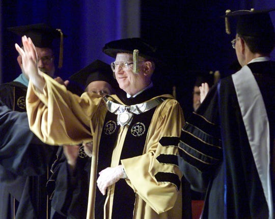 Purdue University president Steven Beering waves during the Purdue summer commencement, August 6, 2000 in West Lafayette, Ind. The summer commencement marked the final graduation for departing president Steven Beering.