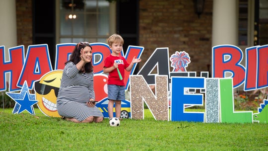 Family and friends bring the party to 4-year-old Neil Thibeaux with a birthday car parade in front of his home in Lafayette, La. Tuesday, April 7, 2020. (Pictured- Cassie Thibeaux and Neil Thibeaux )