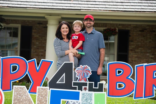Family and friends bring the party to 4-year-old Neil Thibeaux with a birthday car parade in front of his home in Lafayette, La. Tuesday, April 7, 2020. (Pictured- Cassie Thibeaux, BC Thibeaux and Neil Thibeaux )