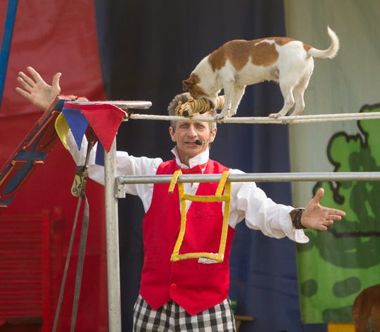 Johnny Peers performs with one of his dogs, Izzy, in the Muttville Comix Show at the Hamburg Family Fun Fest Wednesday, June 12, 2019. This year's Fun Fest has been cancelled due to the coronavirus.