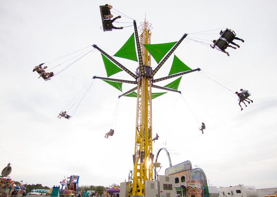 Carnival goers ride the Vertigo at the Hamburg Family Fun Fest Wednesday, June 12, 2019. This year's Fun Fest has been cancelled due to the coronavirus.