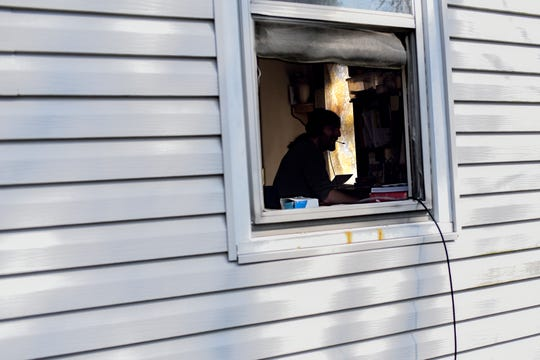 Artist CJ Pratt works on setting up a crowd sourcing Patreon account among other online tasks at his home on Tuesday, April 7, 2020, in Lansing. Pratt just purchased internet access for the first time since the coronavirus outbreak restrictions.