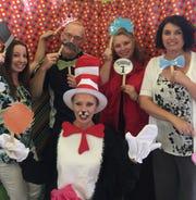 Karen Staton, left, CEO Lester Champer, Jill Miller, and Rebecca Amert of K-City in Shelby are joined by Ellen Eichler, a volunteer for the daycare's Dr. Seuss-themed graduation.