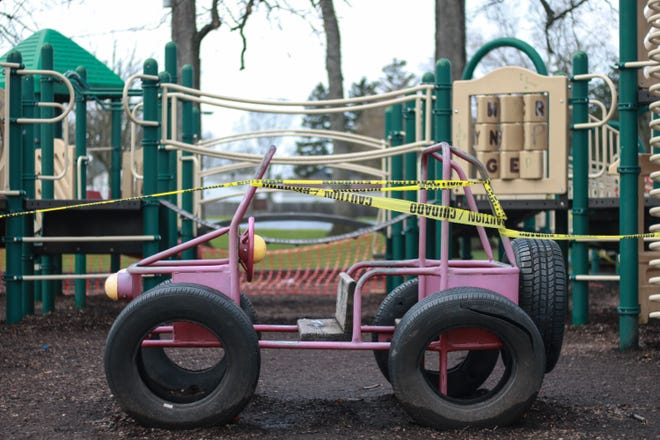 The playground at Garfield Park is taped off and closed to the public under Ohio's stay-at-home order. Ohio has ordered all playgrounds closed during the public health emergency prompted by the novel coronavirus because of the potential for the virus to spread there.
