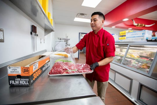 Juan Perez wraps a package of beef Tuesday, April 7, 2020, at Casa Perez in Memphis.