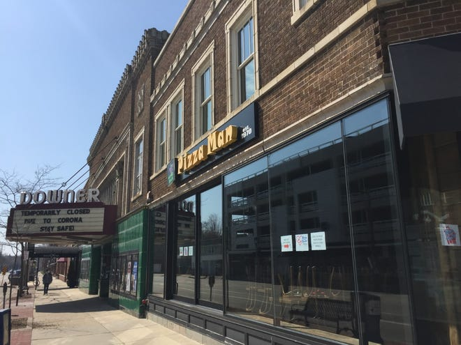 The buildings that house the Downer Theatre, Pizza Man and several other Downer Avenue businesses are getting a renewed focus after being sold to a Seattle-based investment group.