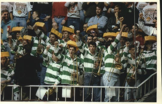 UWGB band members wear their cheeseheads as they cheer during a 61-57 upset of California in an NCAA Tournament regional game in 1994.