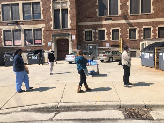 A table was set up to offer snacks and water to voters waiting in line at Milwaukee Riverside on April 7, 2020.