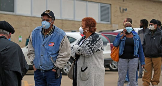 Frank and Deborah Kincaid waited more than an hour in line at Marshall High School to cast their vote in the April 7 Wisconsin primary election.