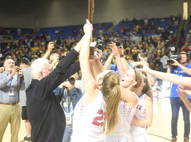 The Melbourne Lady Bearkatz accept the Class 2A State championship trophy after defeating Quitman last month at Hot Springs.
