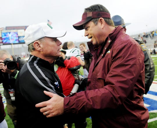 Former ULM football coach Todd Berry (right) and Ohio coach Frank Solich (left) shakes hands following the 2012 Independence Bowl. Ohio beat ULM 45-14.