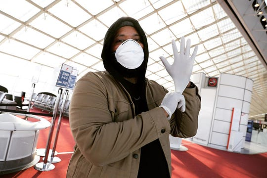 Hip hop artist Big Henri at the airport in Amsterdam on March 31, 2020.