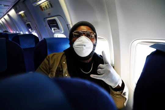 Hip hop artist Let Us Bray on the plane bound to Atlanta on March 31, 2020.