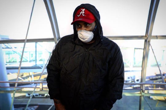 Hip hop artist Let Us Bray at the airport in Amsterdam on March 31, 2020.