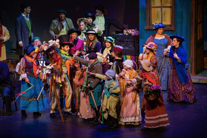 """The second-act market scene from Gulfshore Opera's production of  """"La Boheme"""" at the Charlotte Performing Arts Center."""