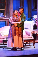 "Mimi (Sarah Tucker) and Rodolfo (Peter Lake) as the young lovers in the Gulfshore Opera production of  ""La Boheme."""