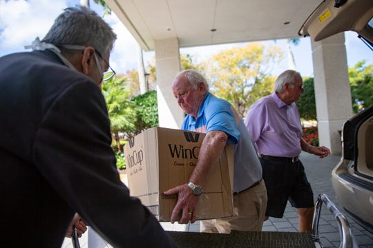 Ted Beisler with Moorings Golf and Country Club unloads donated meals for the staff at Naples Community Hospital Baker, Tuesday, April 7, 2020, in Naples.