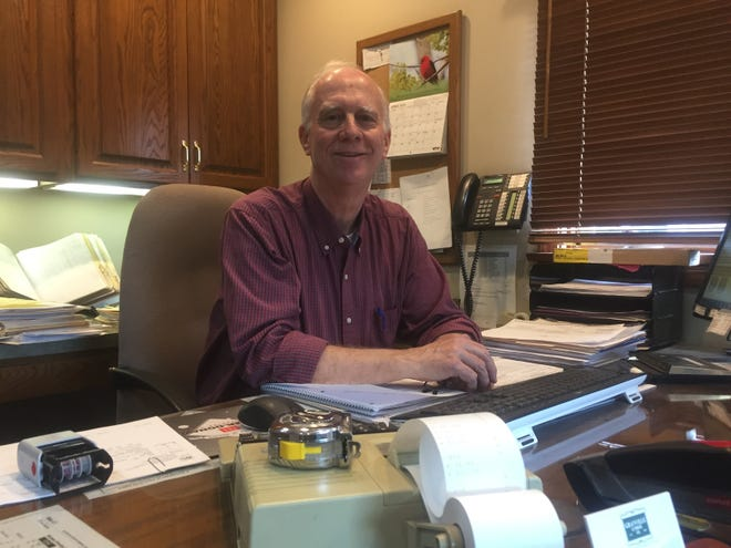 Dave Rutledge sits in his office at Granville Lumber on April 7. The now permanently closed business would have celebrated 70 years in business this month.