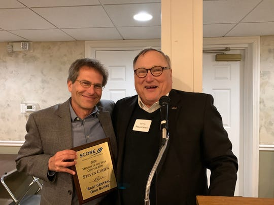 Steve Cohen (left) was honored as the SCORE chapter's Mentor of the Year at the organization's annual dinner.