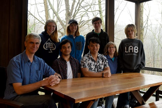 "Denison University students Yash Pandey and Tung ""Steve"" Nguyen (front row, center) have been living with the Miller family of Granville; parents Thomas and Wendy and their five kids Kate, Becky, Eric and Jack (not pictured Nate) since the university closed. Denison placed 69 mostly foreign exchange students with 51 local families because the students are unable to return home during the pandemic."