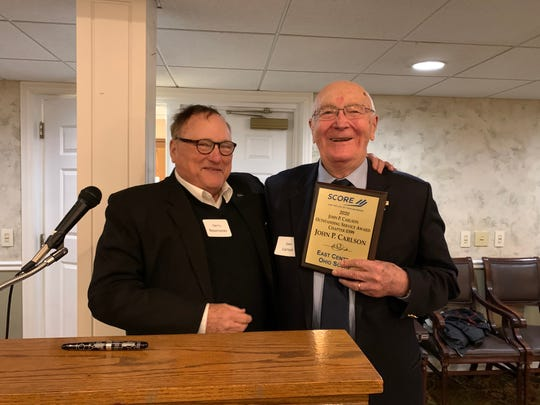 John Carlson (right) received SCORE's first John Carlson Award, created to honor him for more than 20 years of service to the central Ohio business community.