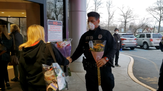 Passaic police officers thanked essential workers at St. Mary's General Hospital in Passaic Tuesday morning with flowers.