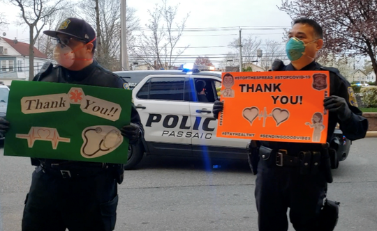Passaic police officers thanked essential workers at St. Mary's General Hospital and Home Depot in Passaic Tuesday morning with flowers and posters.