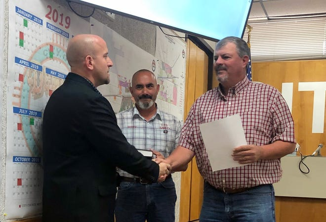 The Honorable Bobby Orosco, left, is congratulated by Deming City Administrator Aaron Sera, at right, and Deming Mayor Benny Jasso.