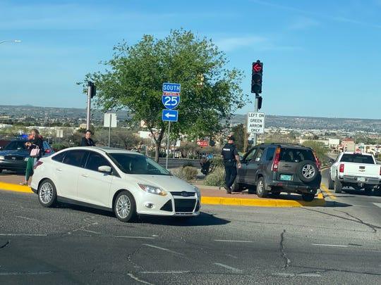 Las Cruces police arrive at a crash site Sunday, April 5, 2020, at the Lohman Avenue overpass at Interstate 25. The driver of the brown Honda SUV exited her vehicle and stripped naked after the crash, witnesses say.