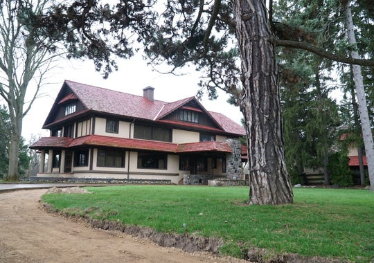 The Haggerty House has about 10,000 square feet of living space among its buildings on the nearly 20 acre plot. Many tall evergreens stand on the property along Canton Center Road.