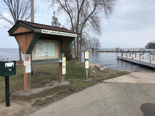Signs indicate the rules for boaters Tuesday, April 7, 2020, at the 24th Avenue boat launch in Oshkosh.