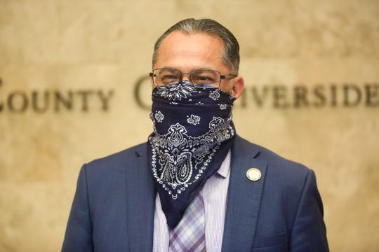 Riverside County Fourth District Supervisor V. Manuel Perez wears a face mask to slow the spread of coronavirus at a Riverside County Board of Supervisors meeting on Tuesday, April 7, 2020, in Riverside, Calif.