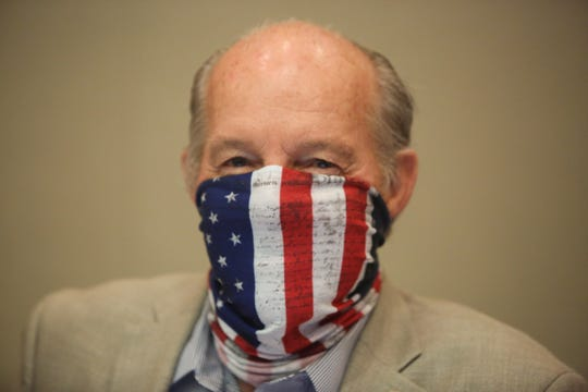 Riverside County Fifth District Supervisor Jeff Hewitt wears a face mask to slow the spread of coronavirus at a Riverside County Board of Supervisors meeting on Tuesday, April 7, 2020, in Riverside, Calif.