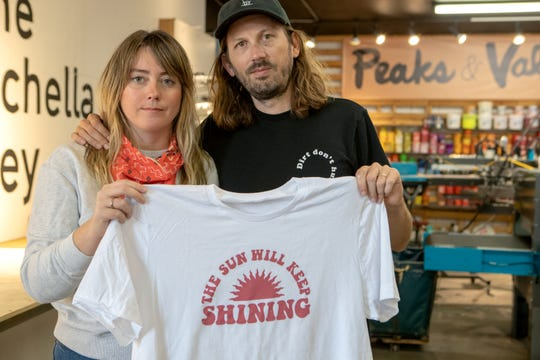 Ashley Busenius Coy and her husband Glen are heading up the #KeepShiningPSP fundraiser to support local businesses and hospitality workers. They are photographed inside their Windmill City Screen Printing shop in Cathedral City, Calif., on April 7, 2020.